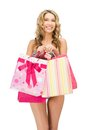 Seductive woman in bikini with shopping bags Royalty Free Stock Images