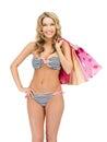 Seductive woman in bikini with shopping bags Stock Photos