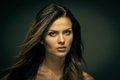 Seductive woman fatal brunette with long hair Stock Photography