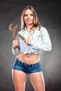 Seductive woman holding monkey wrench feminism sexy alluring gas grips strong girl feminist working in man profession gender Royalty Free Stock Photography