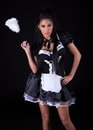 Seductive woman in maids outfit Stock Photos