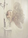 Seductive woman in the mirror nude elegant blonde front of Royalty Free Stock Images
