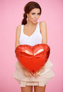 Seductive woman with a red heart Royalty Free Stock Photos