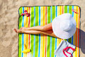 Seductive woman taking sunbathe on beach the Stock Image