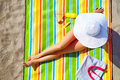 Seductive woman taking sunbathe on beach the Stock Photography
