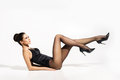 Seductive woman wearing pantyhose and heels with sexy legs up in the air Royalty Free Stock Photo