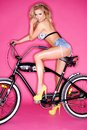 Seductive young blond on a bicycle