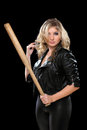 Seductive young blonde with a bat Royalty Free Stock Photo