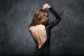 Seductive young woman in evening dress with open back Royalty Free Stock Photo
