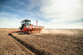 Seeding crops at field farmer Royalty Free Stock Photo