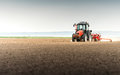 Seeding crops at field Royalty Free Stock Photo