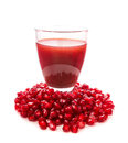 Seeds and juice of a pomegranate isolated image fresh Royalty Free Stock Image