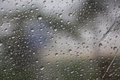 Seeing rain on glass green blur tree background is most beautiful Royalty Free Stock Image
