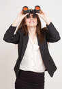 Seeking a career portrait of gorgeous young businesswoman using binoculars Stock Photography