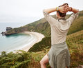 Seen from behind woman hiker enjoing ocean view landscape Royalty Free Stock Photo