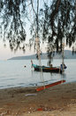Seesaw on tropic beach at the evening with boat water Royalty Free Stock Photo