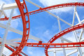 Segment of roller coaster with blue sky Stock Photography