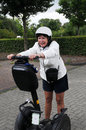 Segway senior woman trys to ride a scooter Royalty Free Stock Images
