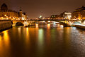 Seine river with pont notre dame and pont au change in paris at night Royalty Free Stock Image