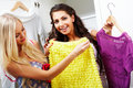 Selecting dresses Stock Photography