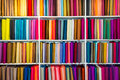 Selection of colorful fabrics shelf with a wide Stock Image