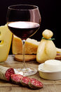 Selection of dairy product, salami and red wine Royalty Free Stock Photography