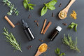 Selection of essential oils and herbs on a dark background Royalty Free Stock Photo
