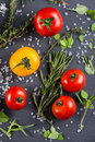 Selection of farm fresh tomatoes with herbs and sea salt from ab Royalty Free Stock Photo
