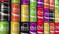 Selection of fizzy soda drinks on a shop supermarket shelf rows different coloured cans with original design Royalty Free Stock Photos
