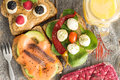 Selection of healthy picnic snacks view from above a sandwiches topped with smoked salmon anchovies avocado mozzarella baby Royalty Free Stock Photo