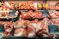 Selection of quality meat at a butcher shop, refrigerated display in the supermarket Royalty Free Stock Photo