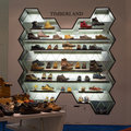 Selection shoes brand name - Timberland on a glass shelf at the Siam Paragon Mall, Bangkok. Royalty Free Stock Photo