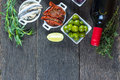 Selection of spanish tapas with red wine from above traditional on wooden rustic table overhead view Royalty Free Stock Images