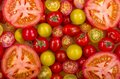 Selection of tomatoes a different types fresh some sliced open Stock Photo