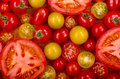Selection of tomatoes a different types fresh some sliced open Stock Photos