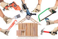 Selection of tools in the shape of a house home improvement concept Stock Photography