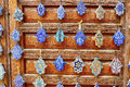 Selection of traditional moroccan amulets khamsa providing defense against the evil eye on a market in fes Stock Image