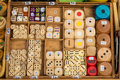 Selection of various handmade wooden dice for sale on a market s