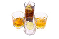 Selection of whiskey on ice over white background Stock Images