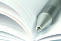 Selective focus of ball pen on opened lined diary book Royalty Free Stock Photo