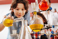 Selective focus of chemical flasks being held by a boy Royalty Free Stock Photo
