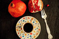 Selective focus on fork for breakfast, pomegranate fruit and fresh coffee Royalty Free Stock Photo