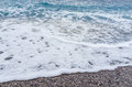 Selective focus Soft gentle waves with foam in blue ocean italy Royalty Free Stock Photo