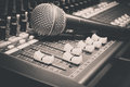 Selective focus sound mixer and blur microphone  background. Royalty Free Stock Photo