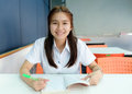 Selective focus on thai young women student reading in library Royalty Free Stock Photo