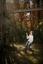 Selective Focus of woman on swing, autumn Royalty Free Stock Photography