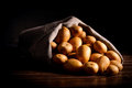Selective raw potato in linen bag on table crude wooden Stock Photography