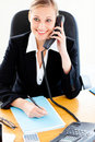 Self-assured businesswoman phoning and writing Stock Photo