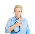 Self checkup closeup portrait senior mature woman business person worker listening to her heart with stethoscope isolated on white Stock Photography