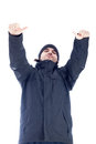 Self confident man in winter clothes showing thumbs up isolated on white background Royalty Free Stock Image
